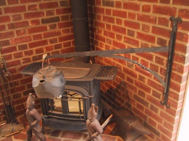 Woodstove hearth crane holding kettle
